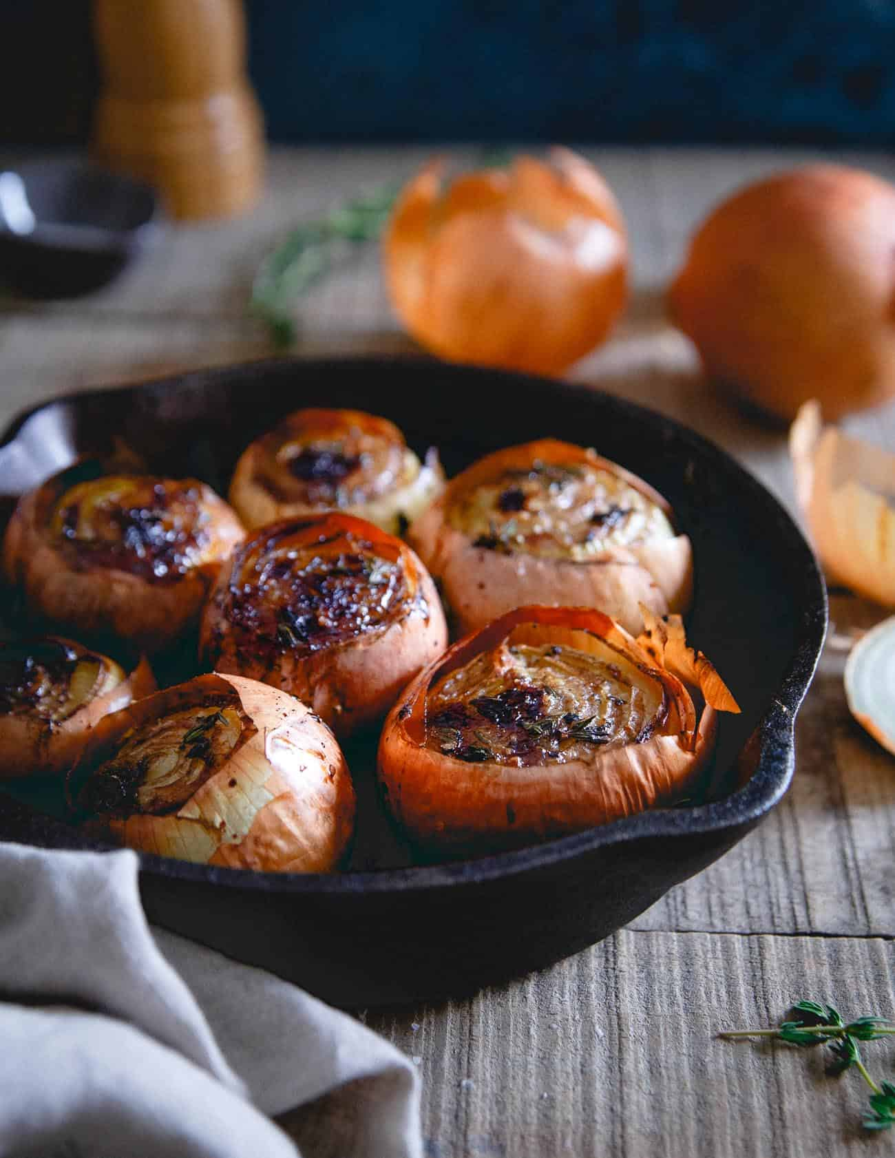 Roasting whole onions with thyme, balsamic and butter leaves them buttery, soft and almost melting in your mouth. A great winter side dish!