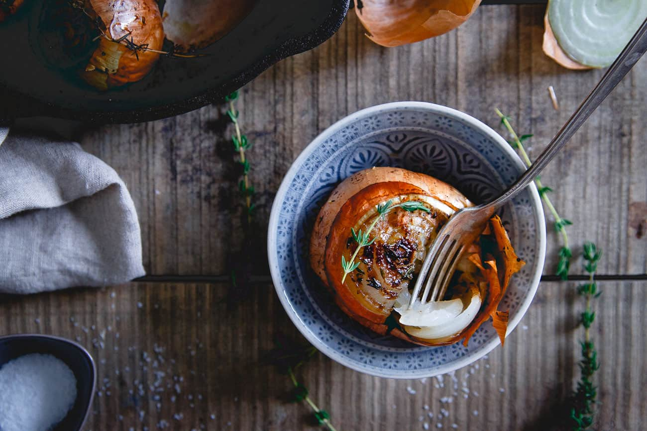 Balsamic and thyme gives these whole roasted onions a delicious deep flavor profile making them a great dinner side dish.