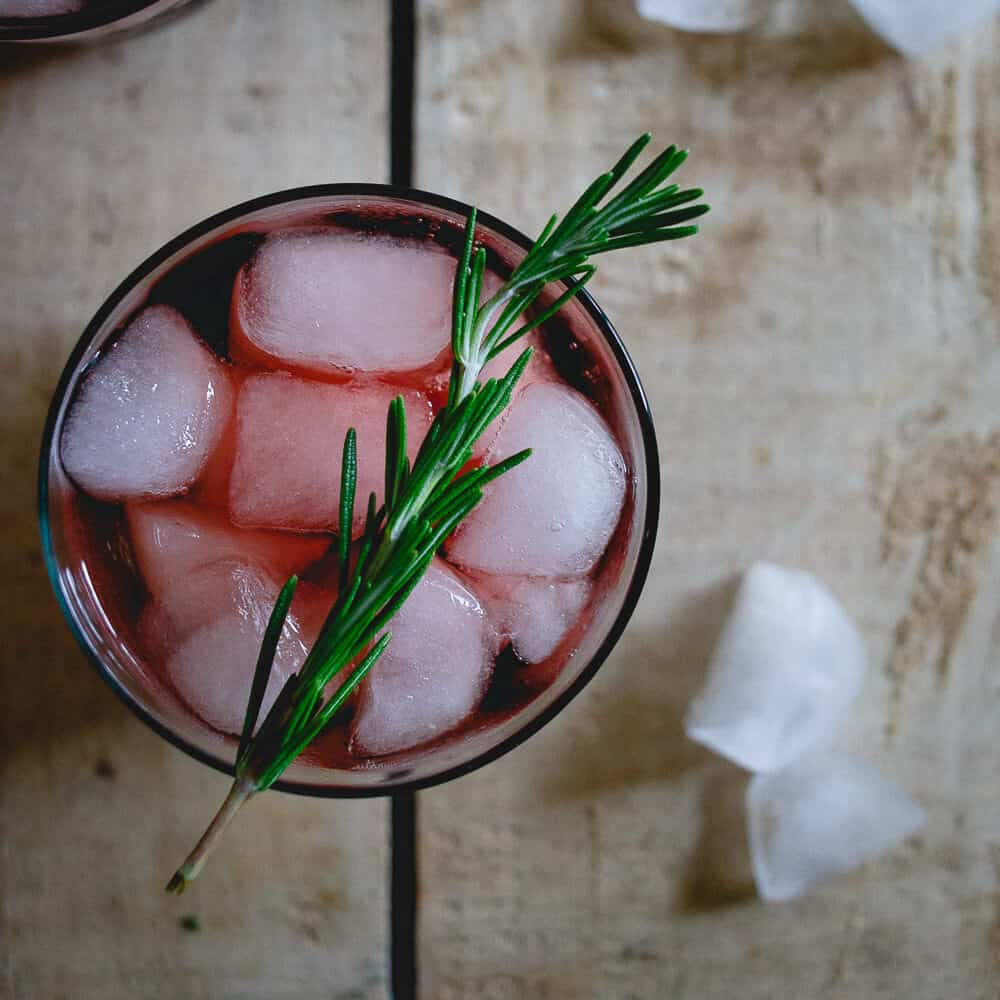 This cherry red wine spritzer is made with tart cherry juice infused with rosemary. It's an easy holiday drink or fun way to change up your normal glass of red.