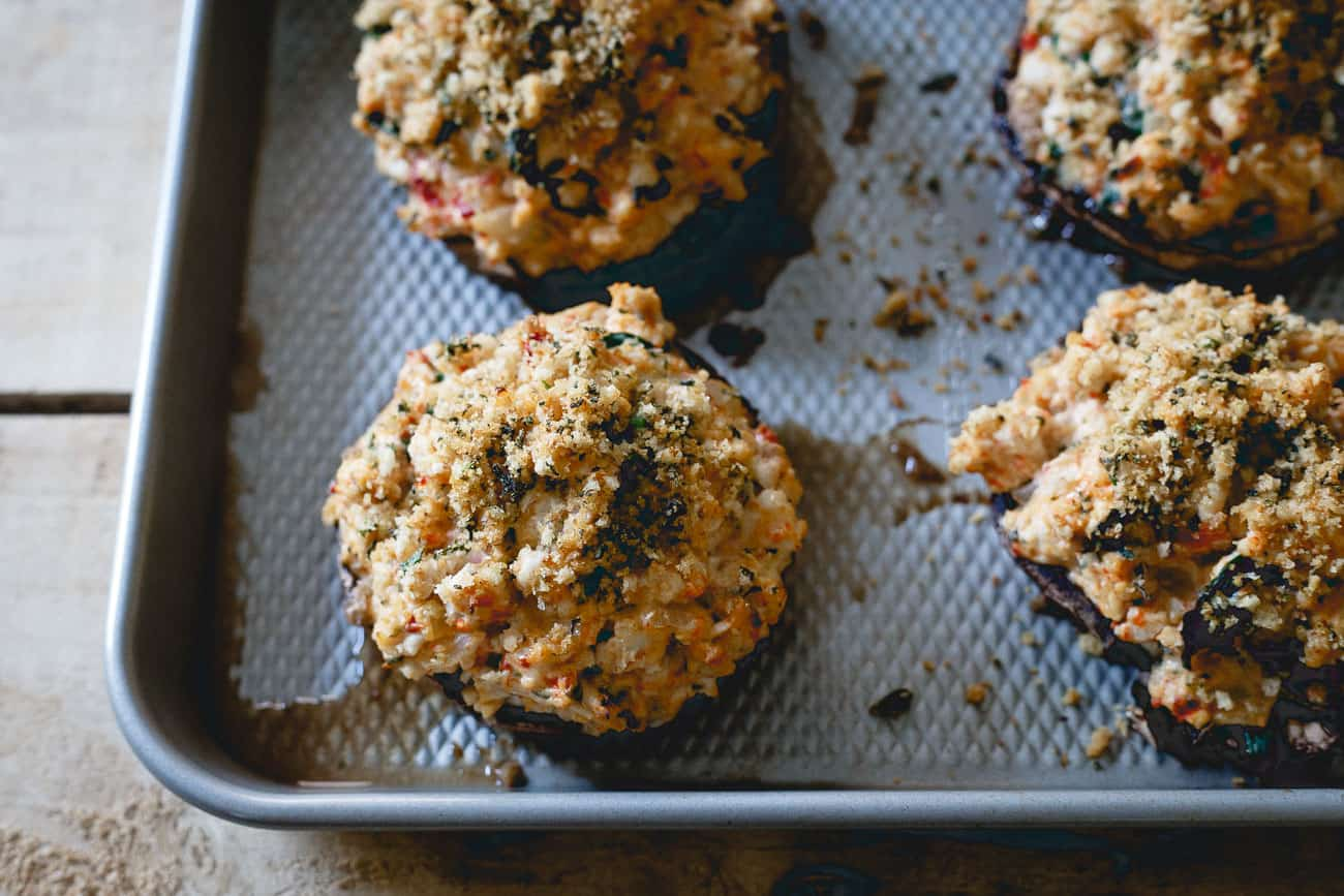 Ground turkey, spinach, black garlic cheese and roasted red peppers make these stuffed portobello mushrooms a delicious dinner!