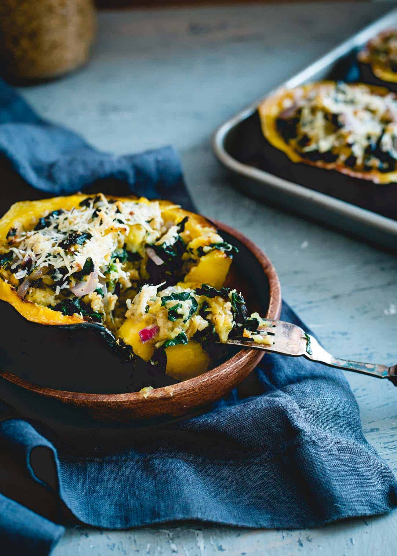 Cheesy, hearty and packed with healthy superfoods and protein, these twice baked acorn squash are a must for your fall dinner table!