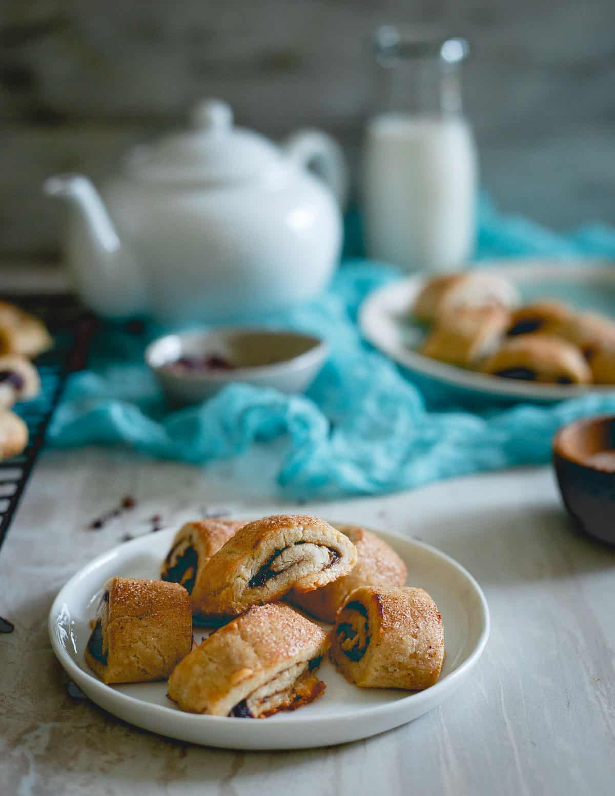 These gluten free apple butter rugelach are studded with cacao nibs for a crunchy bite. They're buttery, soft and a fun cookie option for the season!