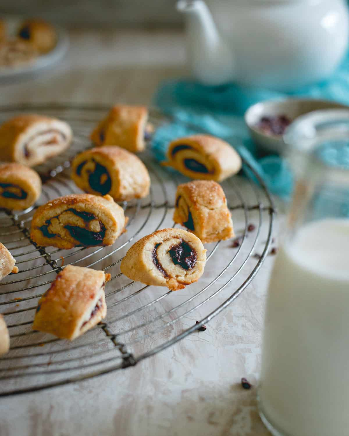 Chewy, buttery soft rugelach are made gluten free and festive for the season with an apple butter filling.