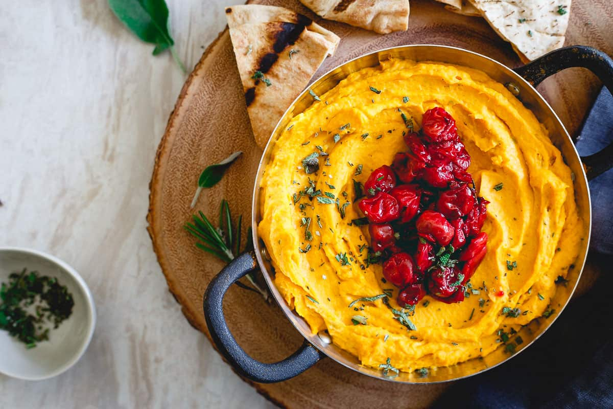 People won't be able to keep their hands out of this festive butternut squash goat cheese dip!