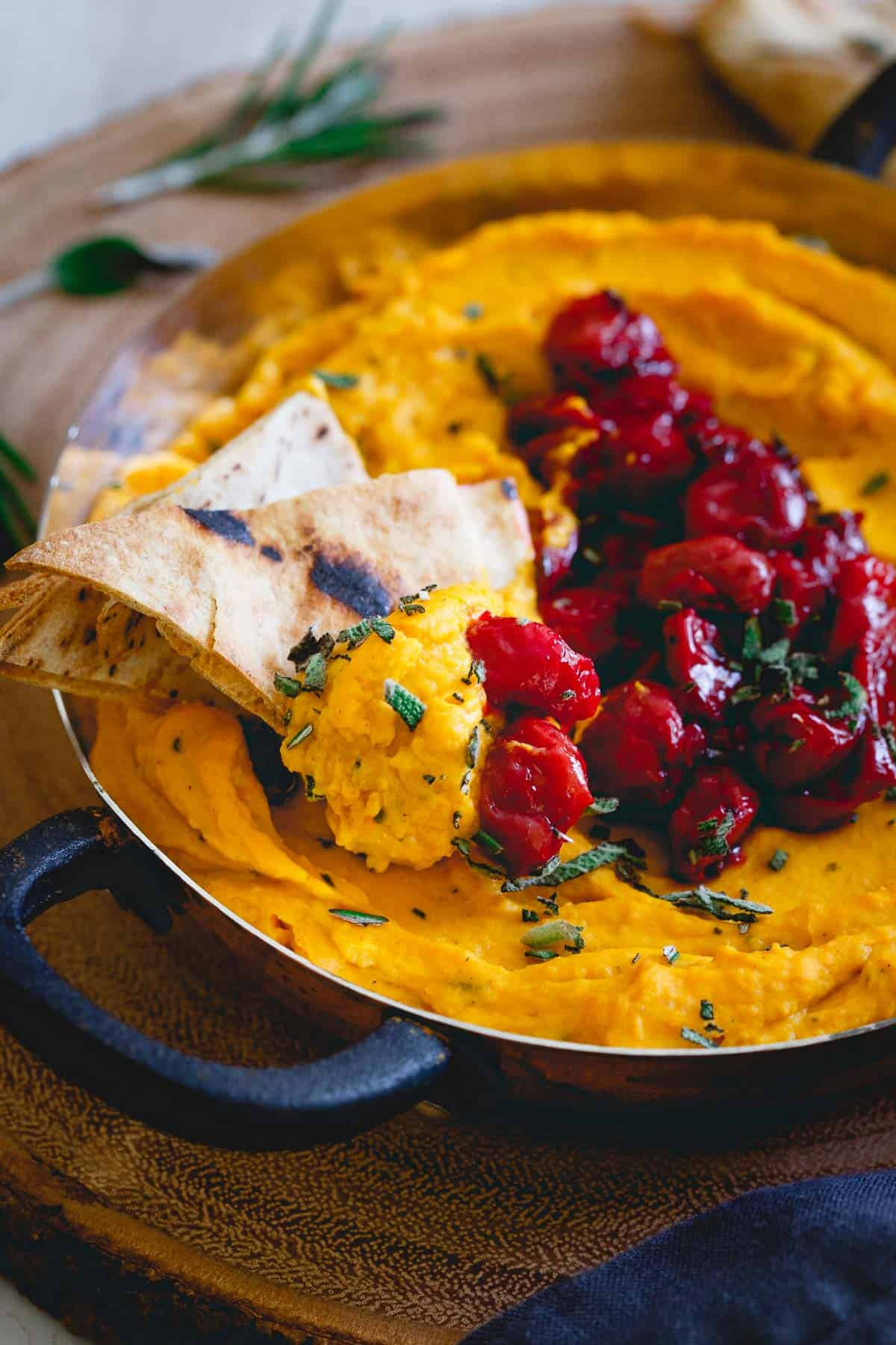 Creamy butternut squash dip is topped with a simple tart cherry compote for a festive appetizer.