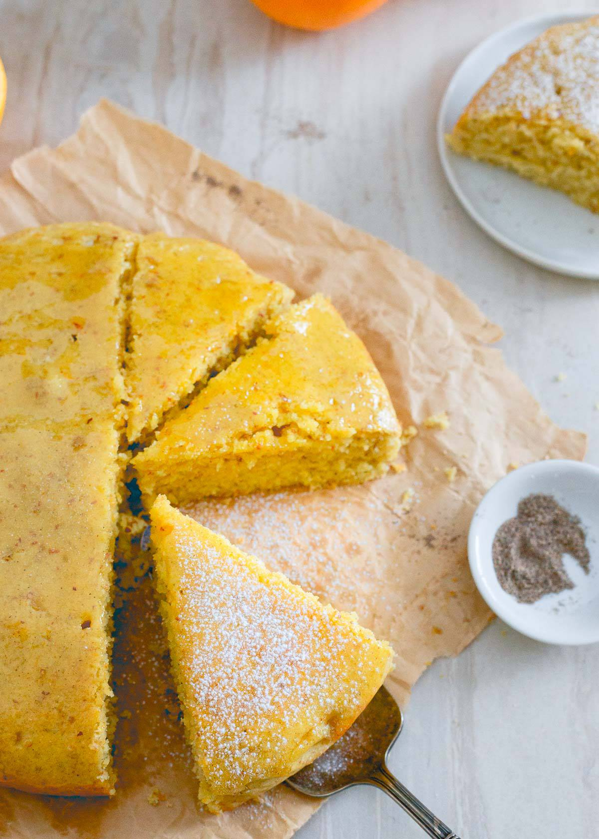 This glazed orange cardamom cake is a wonderfully simple dessert bursting with winter citrus and spice. It's moist, hearty texture and sticky glaze make it perfect with a cup of tea.