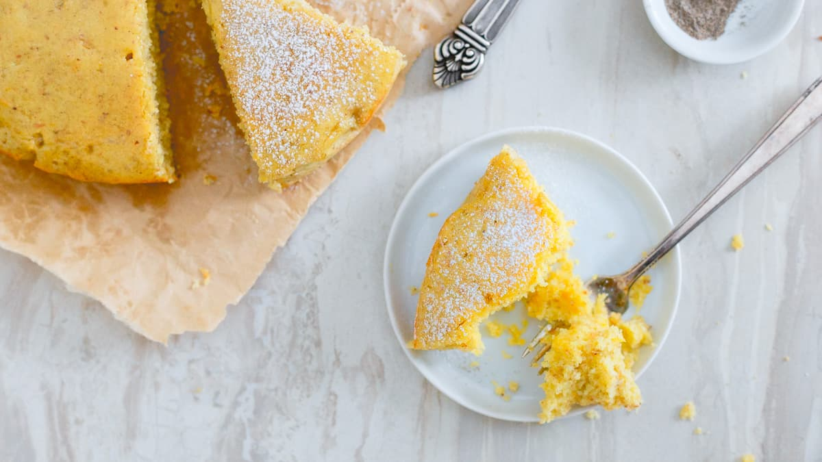 This moist, hearty orange cardamom cake is the perfect with a hot mug of your favorite winter drink is the best way to celebrate this holiday season.