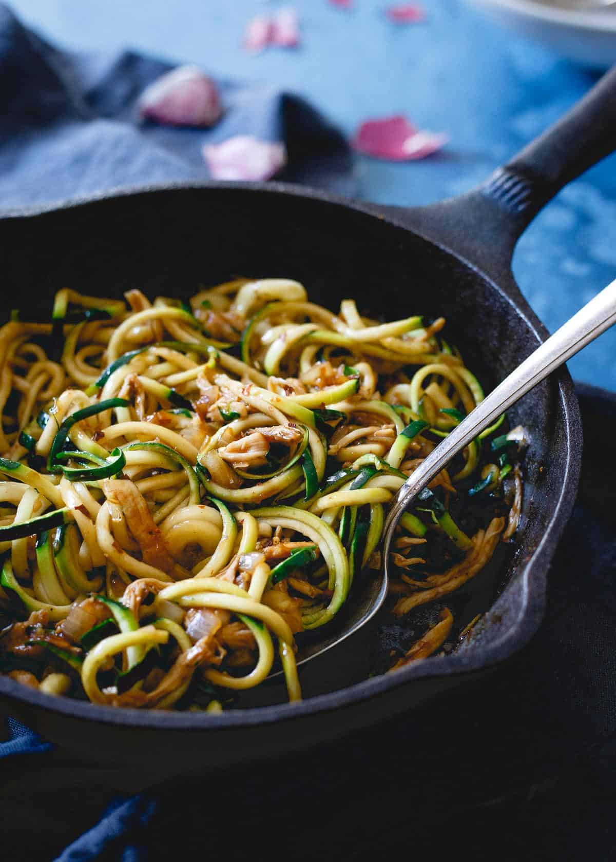 New Years is the perfect time to pick up a spiralizer and make healthier versions of your favorite takeout meals like this Chinese chicken zoodle dish!