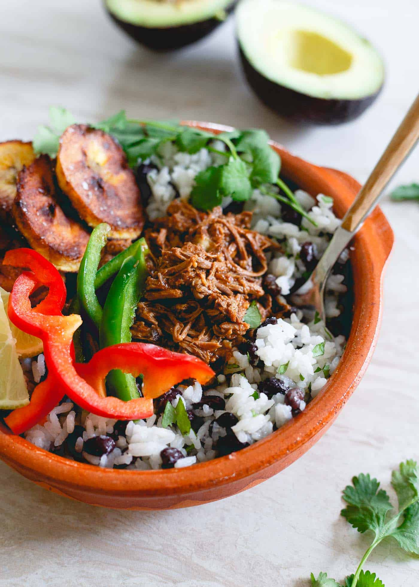 If you're looking for an easy meal prep idea, try these Mexican shredded beef bowls. Made in the slow cooker, they're easy to pack up for lunches and dinner all week long!