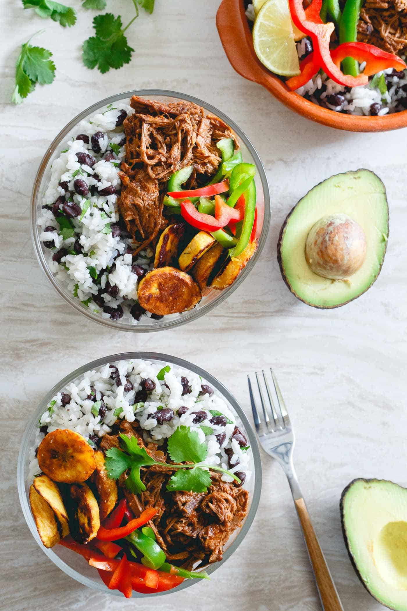 Make a batch of this slow cooker Mexican shredded beef and assemble into bowls at the start of the week for easy lunches and dinners.
