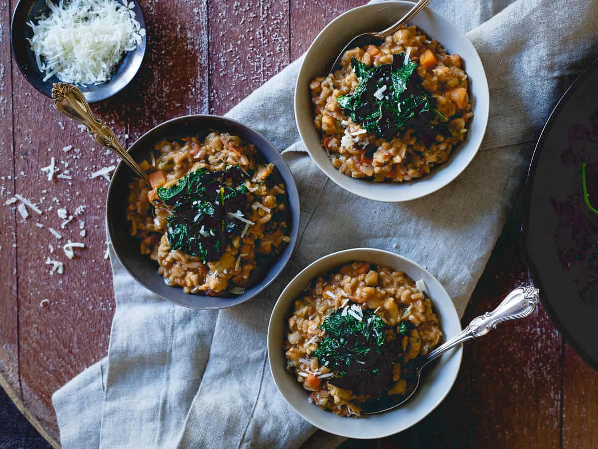 Tuscan white bean farro risotto is the perfect cozy dish on a cold winter day.