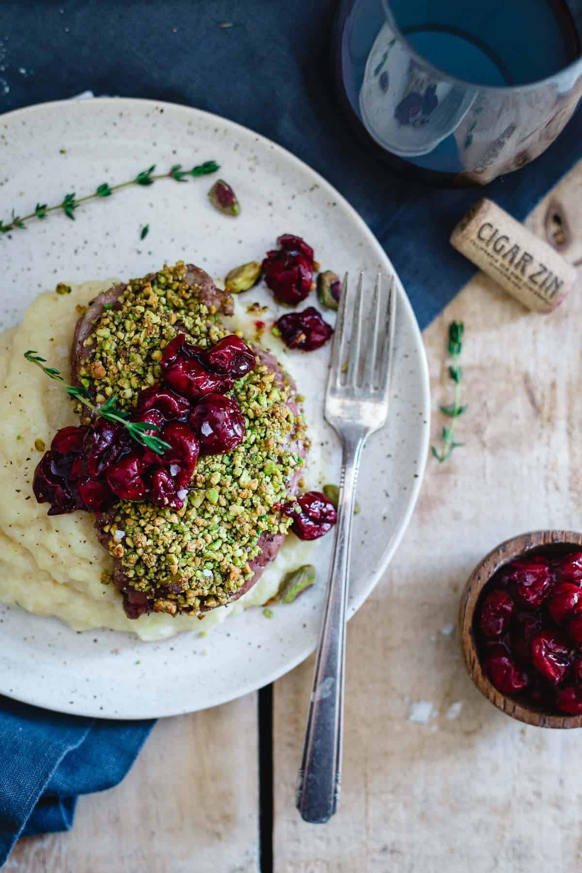 These pistachio crusted lamb chops with red wine cherries are a simple, yet elegant dinner sure to impress that special someone.