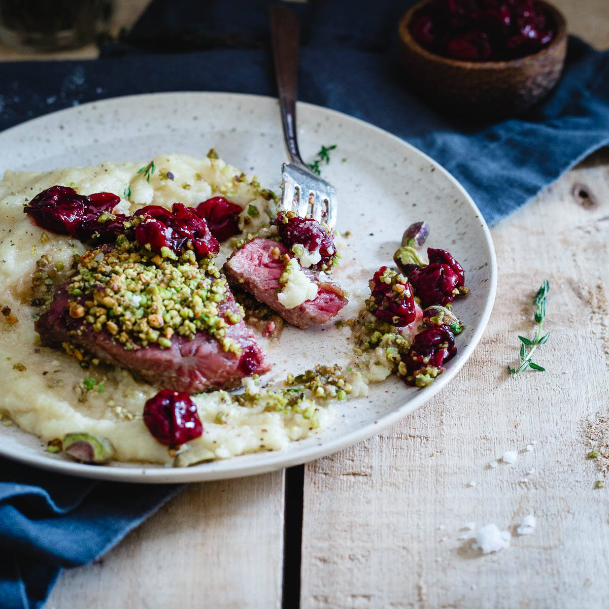 A Valentine's Day dinner better than any restaurant, pistachio crusted lamb chops with red wine cherries and parmesan polenta.
