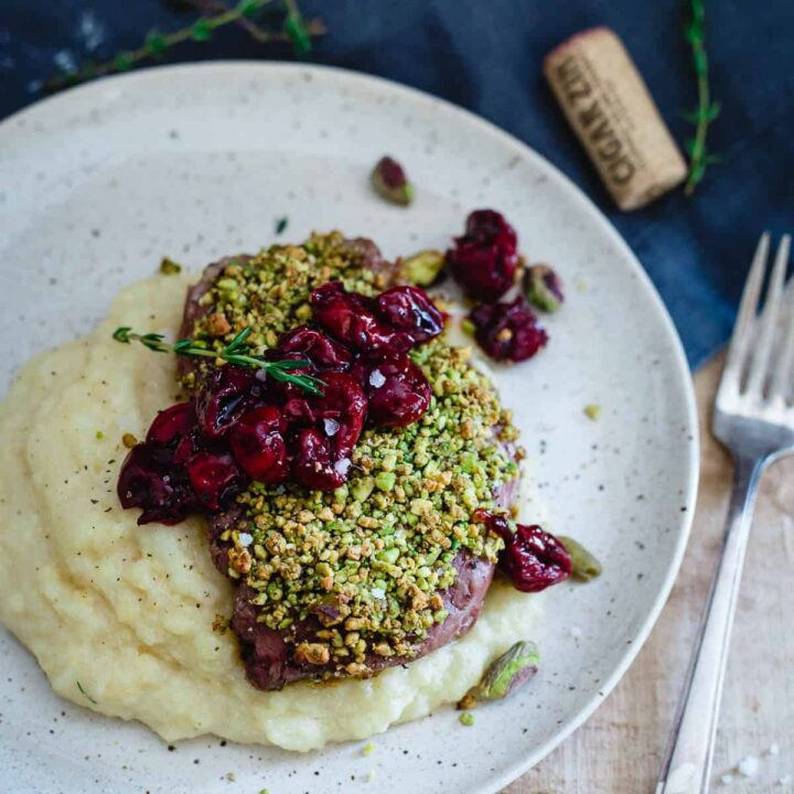 Pistachio Crusted Lamb Chops with Red Wine Cherries