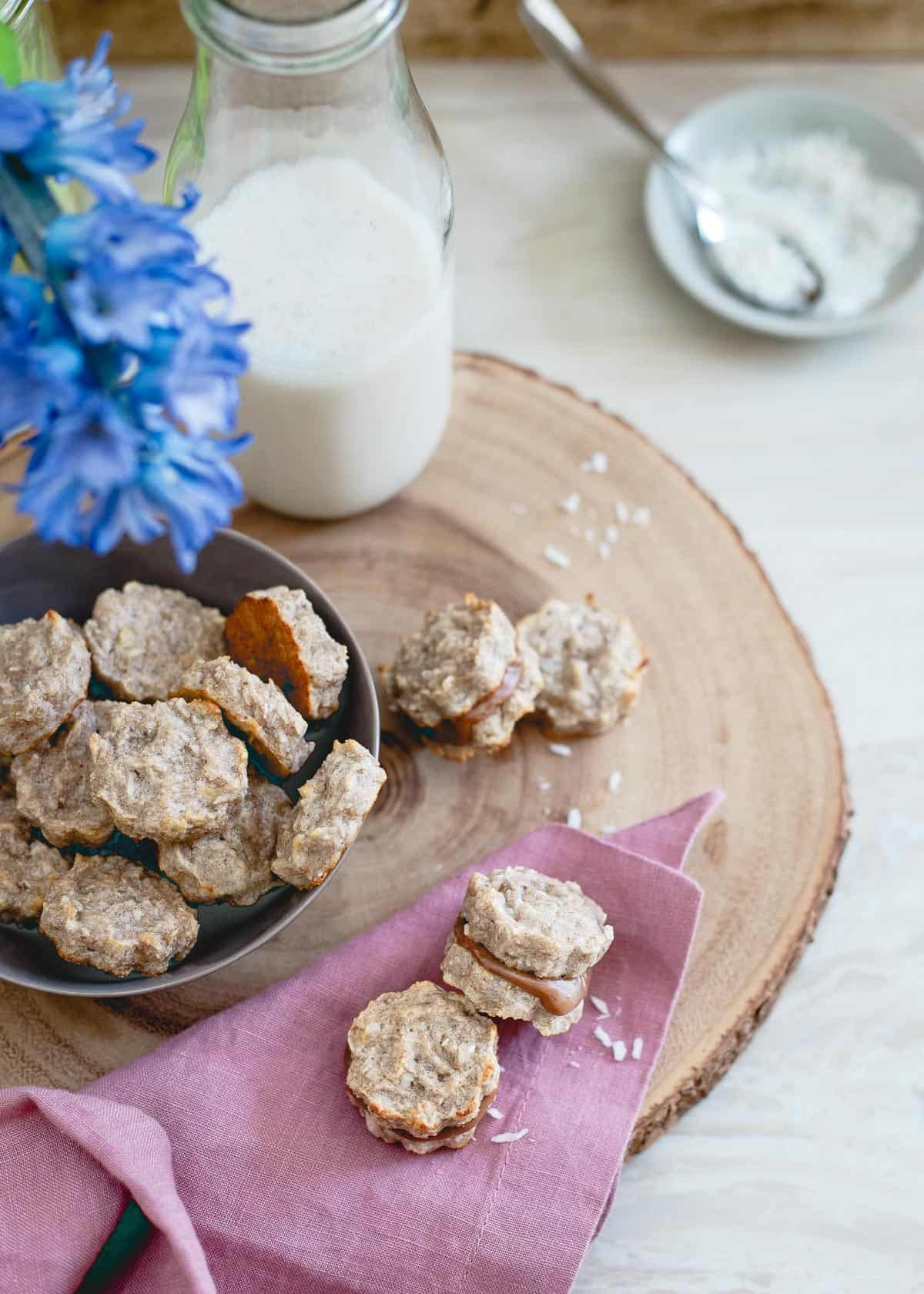 Bite-size banana macaroon sandwich cookies are both grain-free and gluten-free so you can feel good about this sweet snack.