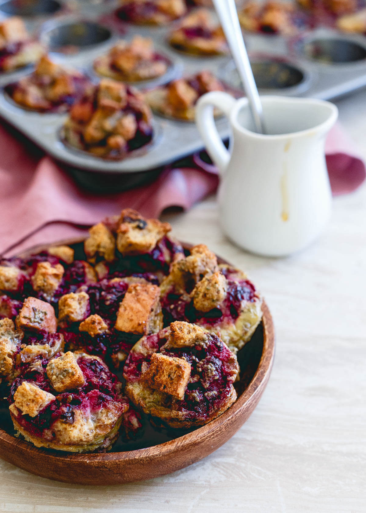 These cinnamon raisin French toast bites are bursting with fresh blackberry ginger sauce. Baked in a mini-muffin tin, they're the perfect size for breakfast on the go!