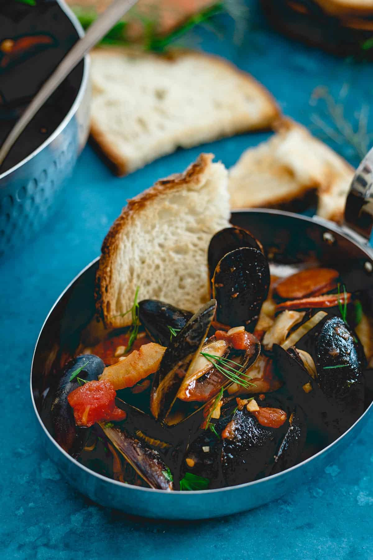 Soak up the delicious tomato broth in these chorizo chili mussels with some crusty warm bread.