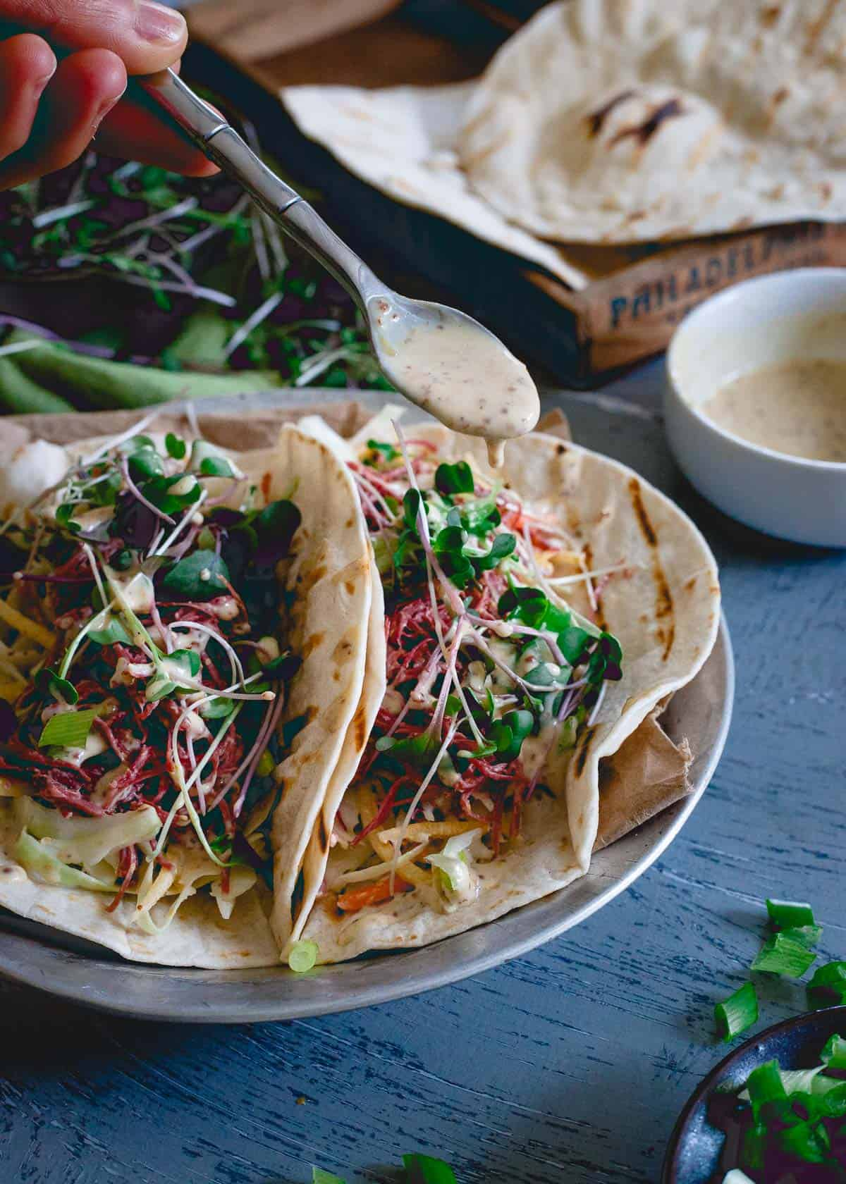The spicy brown mustard sauce totally makes these corned beef tacos. They even have a horseradish kick to them too!