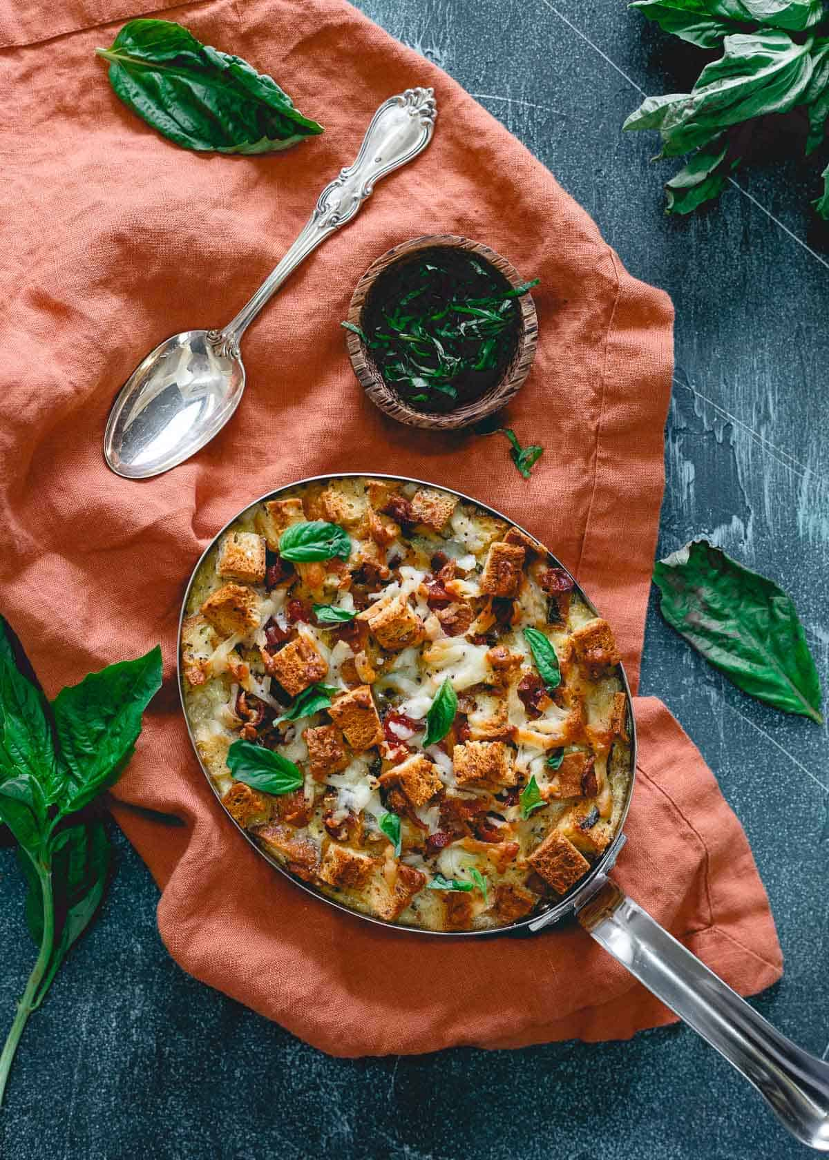 This everything bagel breakfast strata is perfect for Mother's Day. With bacon, cheese, basil and sun-dried tomatoes it's a delicious gluten-free brunch!