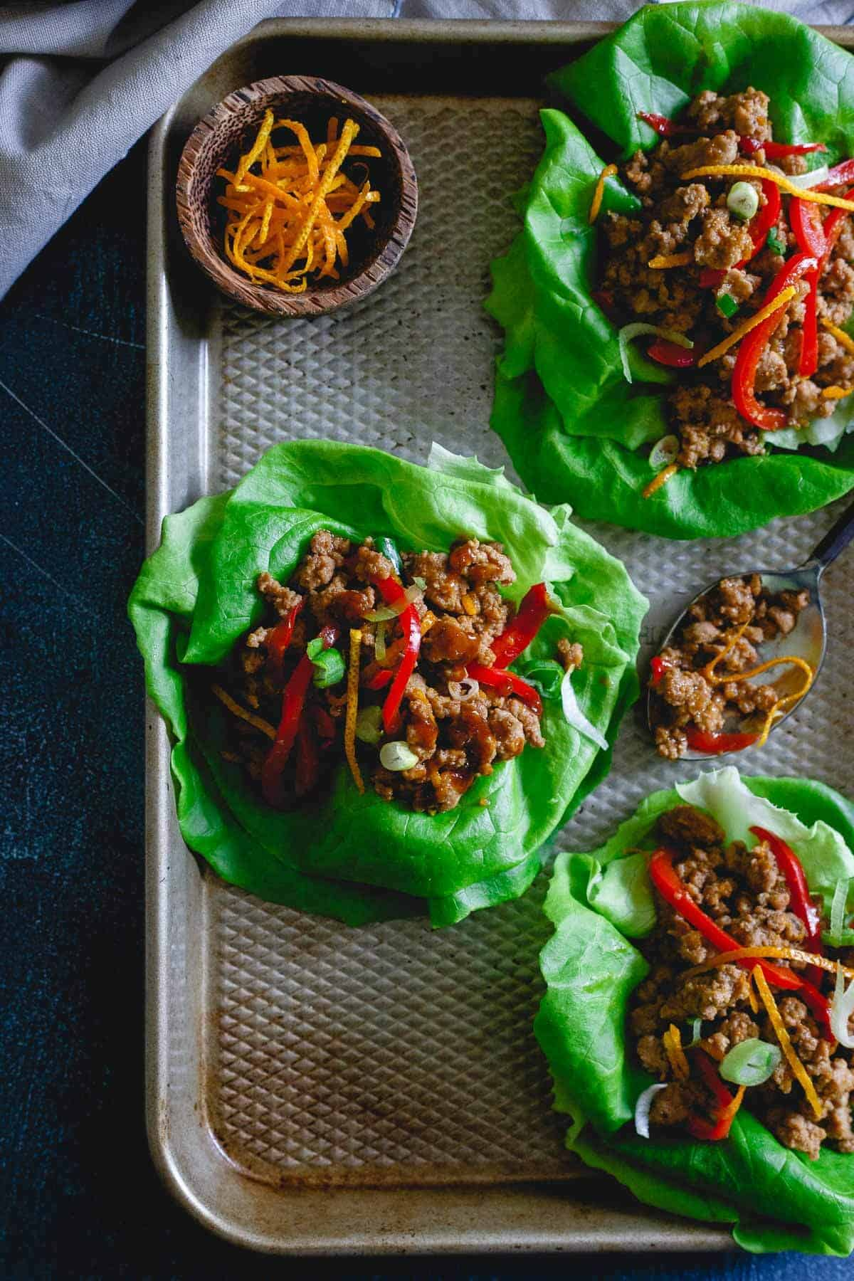 These turkey Asian lettuce wraps are infused with a sticky, sweet, savory and slightly spicy orange sauce making them an irresistibly easy and tasty meal.