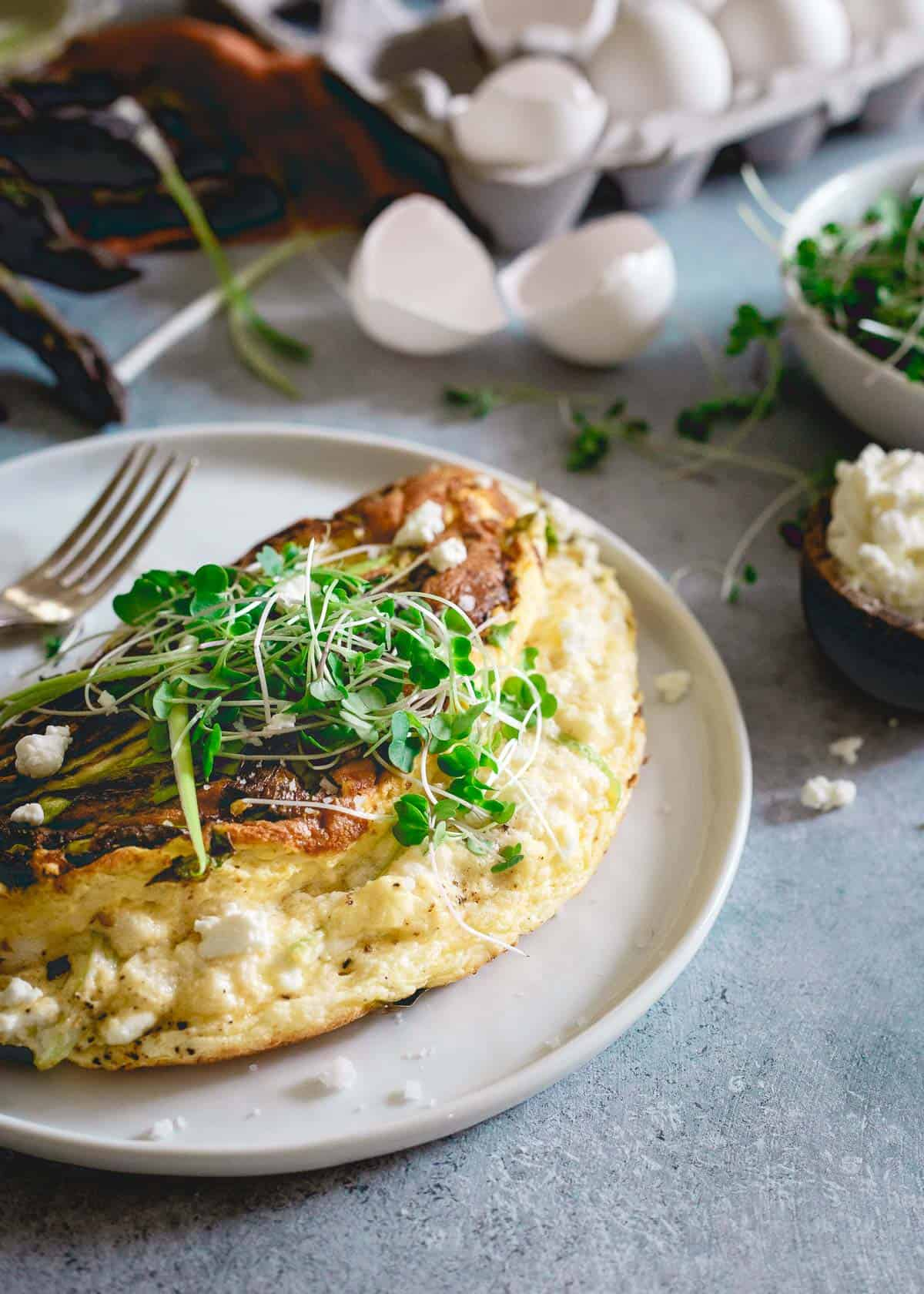 This omelette soufflé is a light and fluffy breakfast bursting with fresh spring ingredients like asparagus, green onions and creamy tart goat cheese.