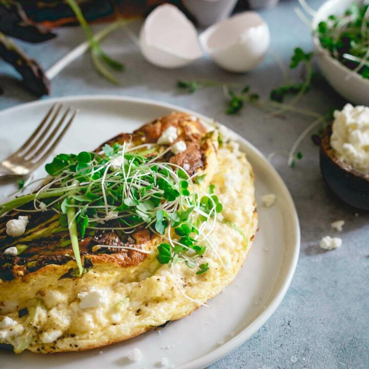 This omelette soufflé is a light and fluffy breakfast bursting with fresh spring ingredients like asparagus, green onions and optional creamy tart goat cheese.
