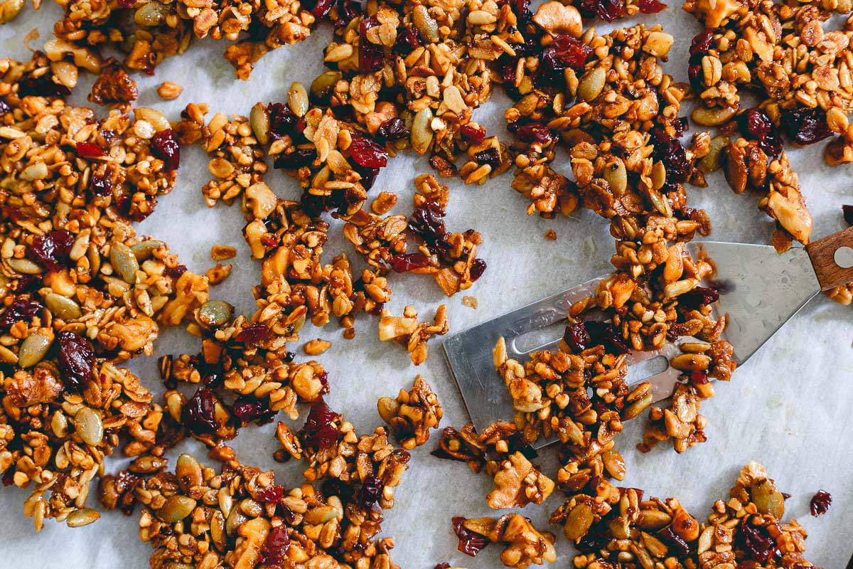Savory tart cherry granola is the perfect crunchy addition to this bay scallop and baby kale salad with grilled corn.