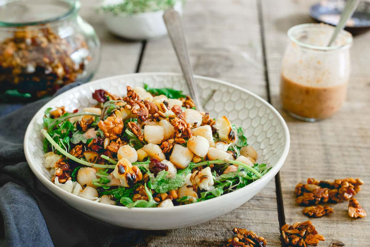 Summer salads don't have to be boring and this bay scallop baby kale and grilled corn one proves it. Topped with a savory tart cherry granola, it's healthy eating made delicious!