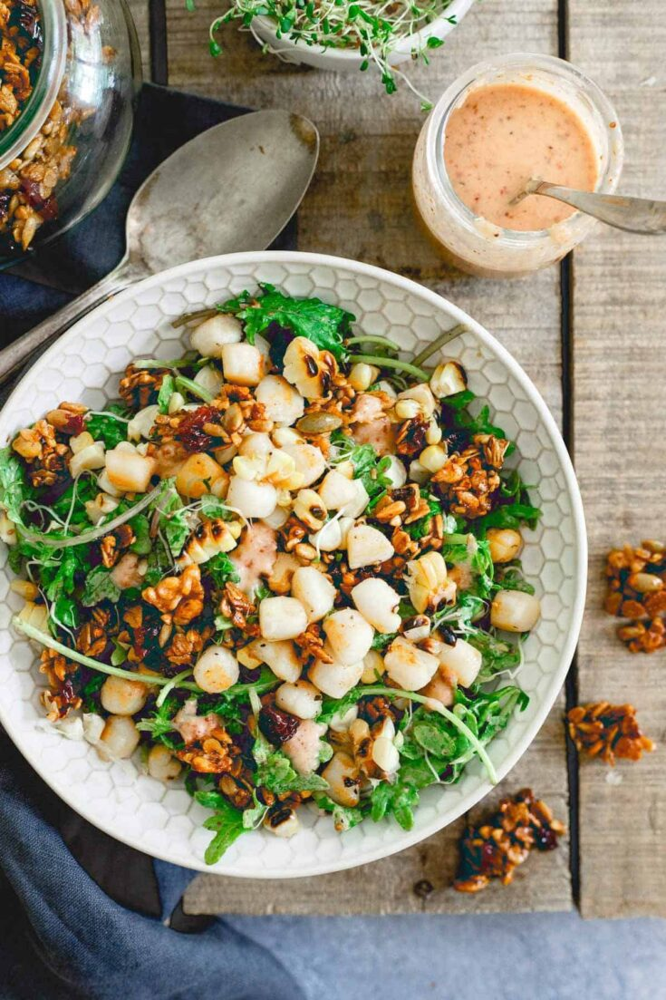 This bay scallop baby kale corn salad is served with a savory tart cherry granola and a cherry dijon dressing. Eating well in the summer never looked so good!