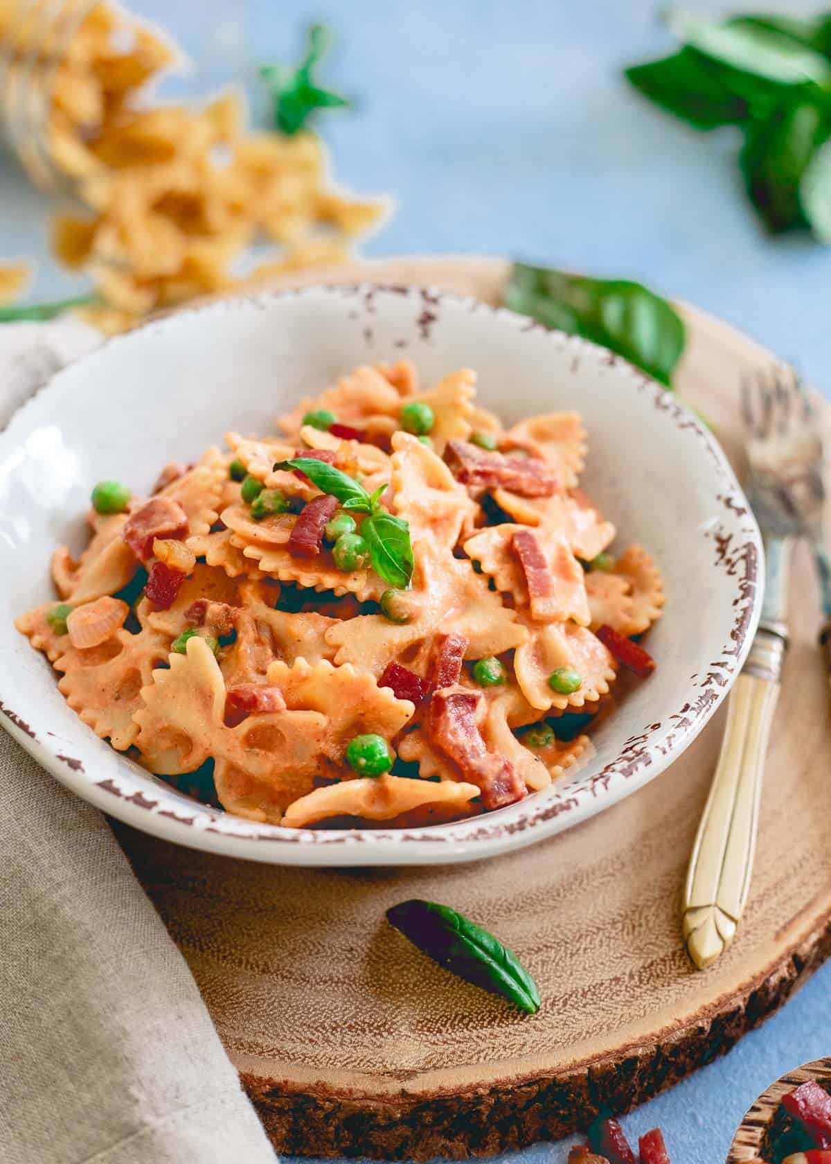 Creamy tomato sauce made right in your blender coats this easy pasta dish with peas and crispy prosciutto.