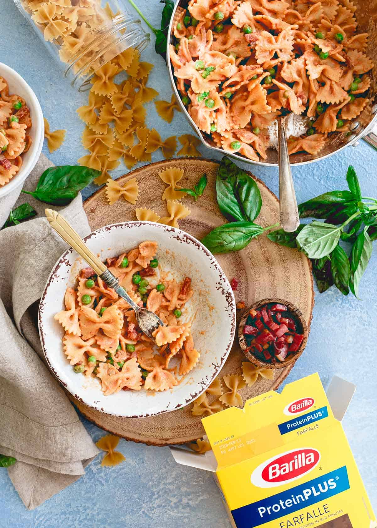 Packed with lean protein, Barilla's ProteinPlus farfalle is a great way to get an easy and healthy meal on the table at dinner time in this creamy tomato farfalle.