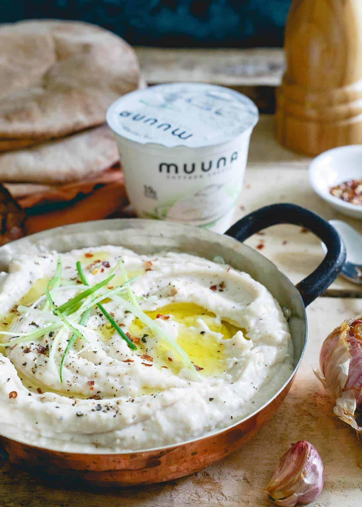 This roasted garlic white bean dip has a secret ingredient: cottage cheese! It lends a super creamy texture and healthy protein boost to each bite.