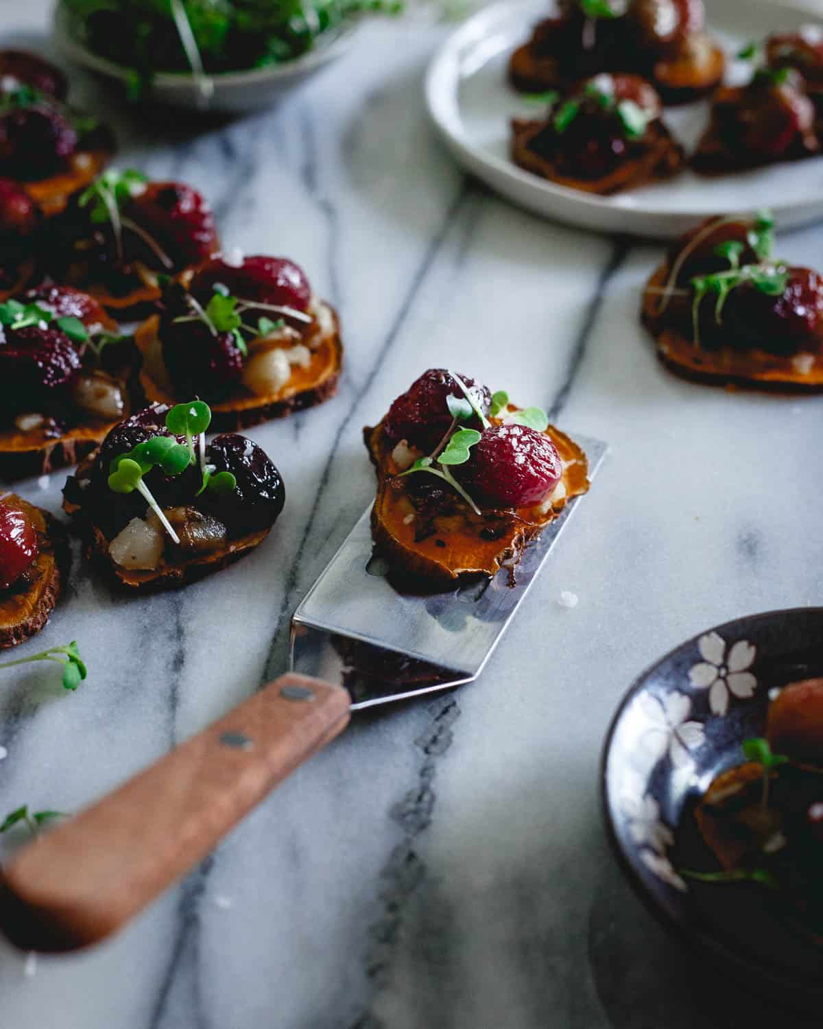 A party appetizer everyone can enjoy, these vegan, gluten-free sweet potato crostini have both sweet grapes and savory caramelized onions with a hint of spice. They're a flavor explosion!