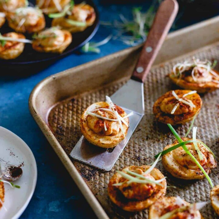 These hummus stuffed potato cups are full of smoky spice flavor and the perfect little roasted bite for a slightly out of the box appetizer or side dish.