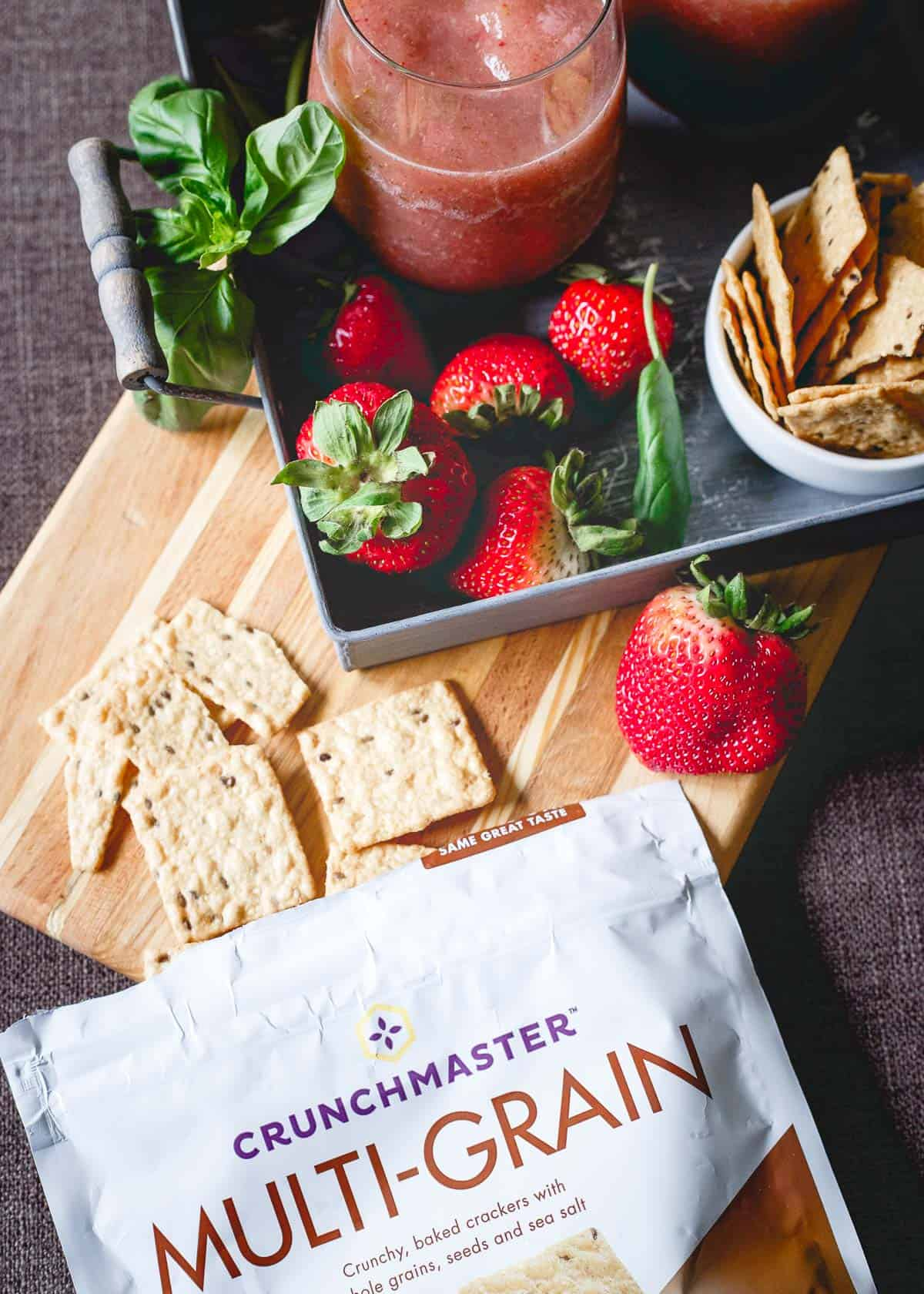 Strawberry Basil Cider Slushies are the perfect summer drink. Pair them with some gluten-free multi-grain Crunchmaster crackers for an easy happy hour!