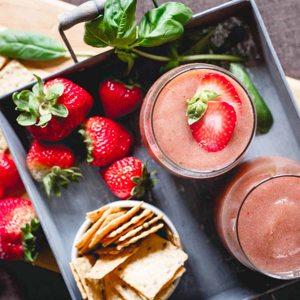 With just 3 ingredients, these strawberry basil cider slushies and some Crunchmaster crackers straight out of the bag make a great summer happy hour!
