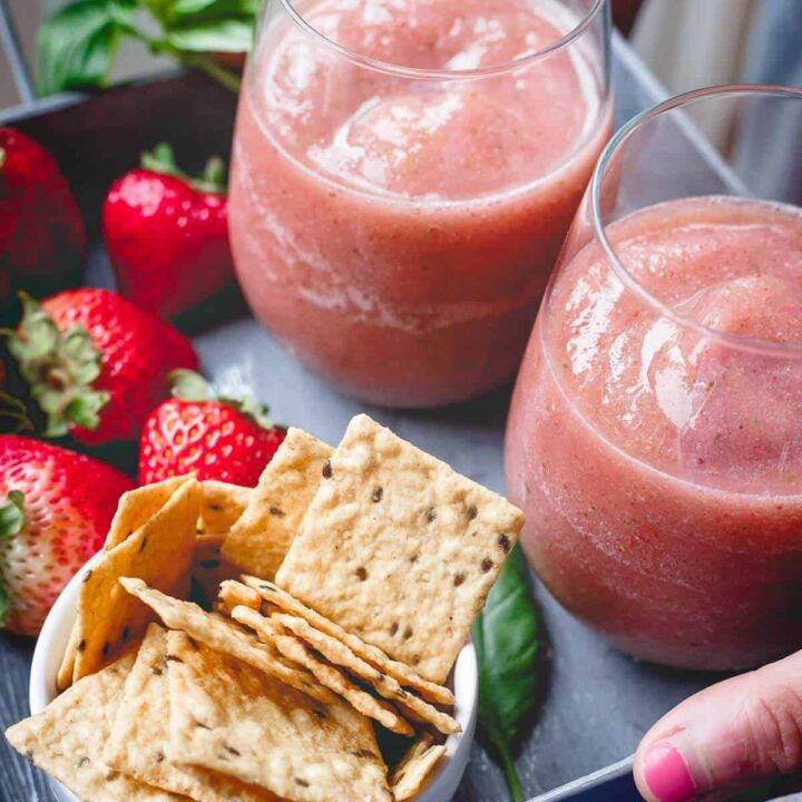 These strawberry basil cider slushies are the perfect refreshing summer drink. Just 3 ingredients and your blender for the happiest of happy hours!