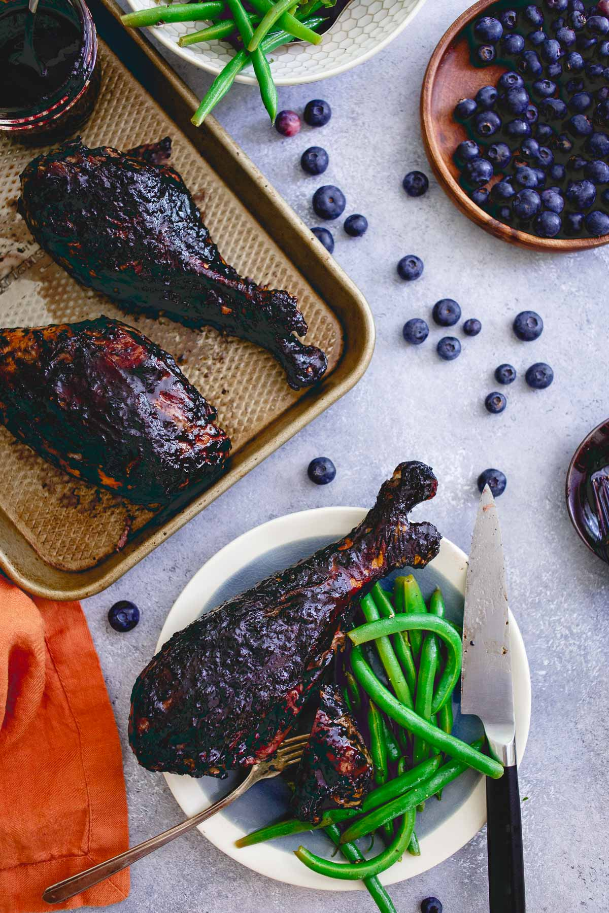 These blueberry balsamic BBQ turkey legs are grilled to perfection while coated with this deliciously easy summer BBQ sauce giving the famous Disney dish a run for its money!