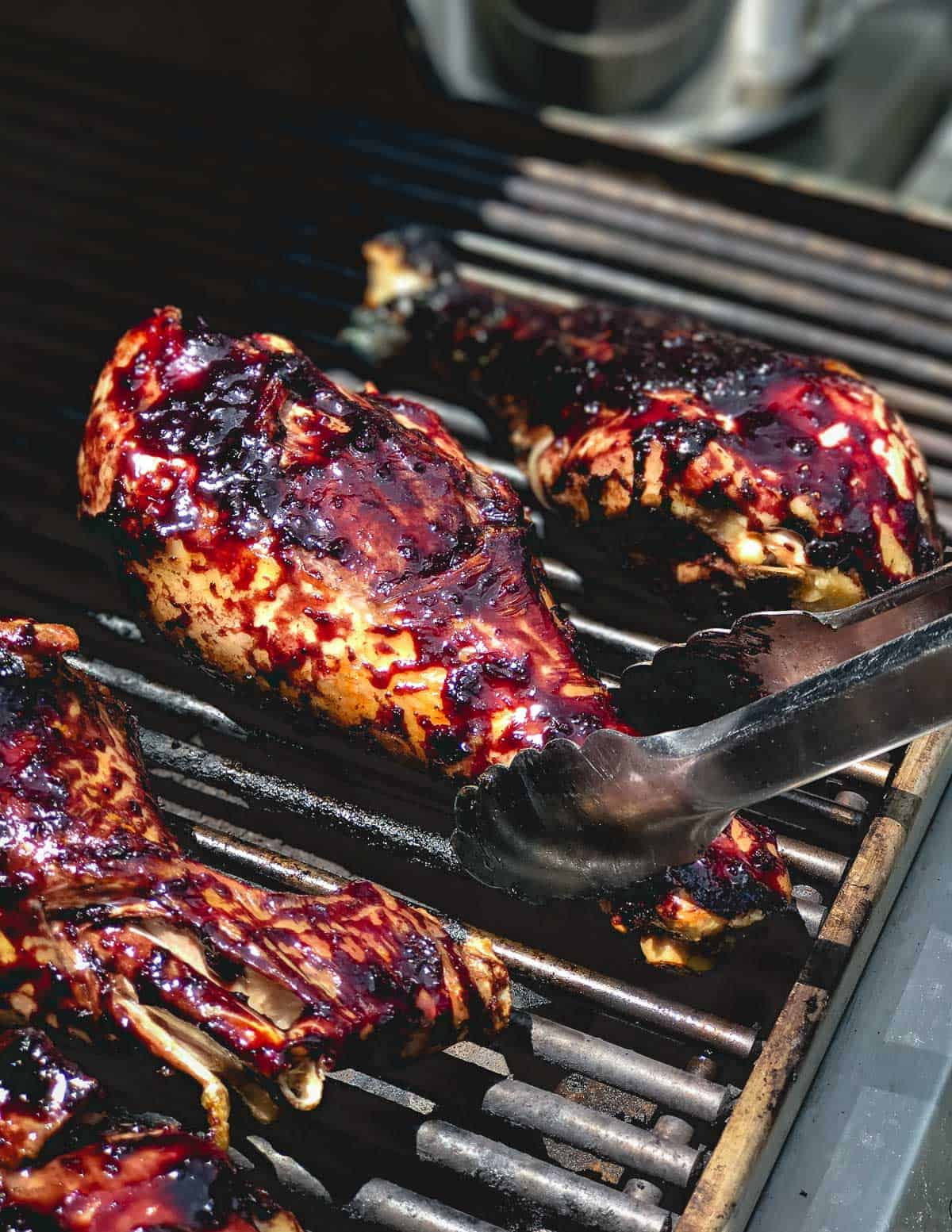 Turkey legs are grilled to perfection and coated with a sweet and tangy blueberry balsamic BBQ sauce.