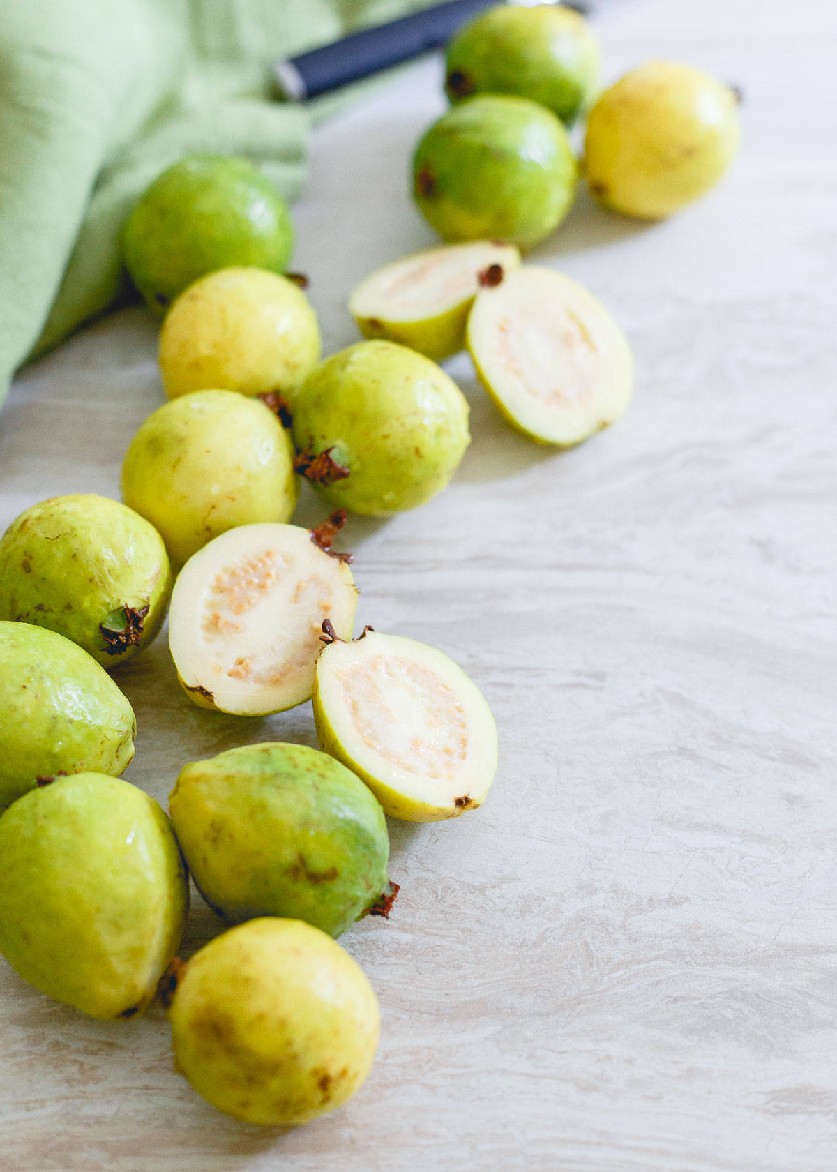 Ripe summer guava fruit goes so well with pineapple for a refreshing summer smoothie.
