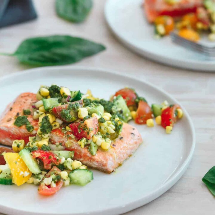This salmon with tomato corn salsa is quickly seared on a hot a skillet and served with a refreshing salsa bursting with summer produce!