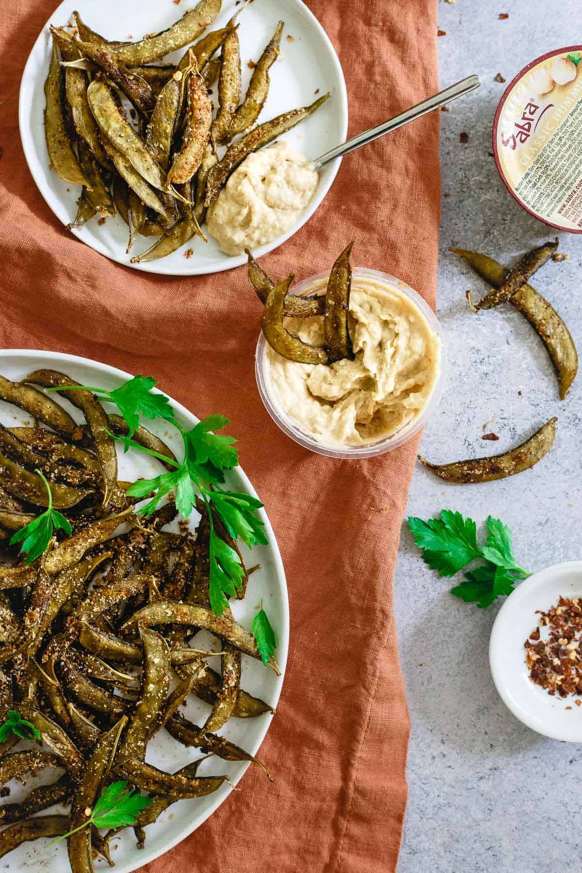 Creamy hummus and homemade snap pea crisps are a great way to keep things healthy when snacking.