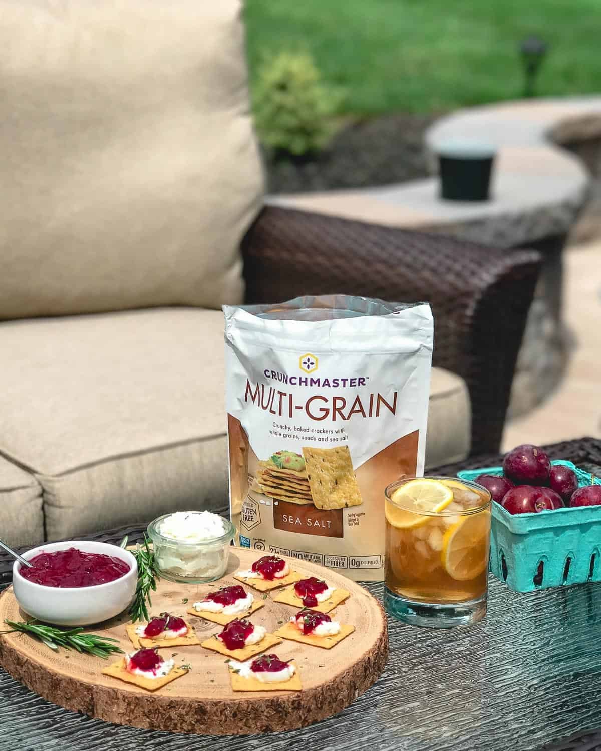 Crunchmaster sea salt crackers are perfectly paired with chinese five spice plum jam and honey sweetened goat cheese for a simple summer snack.