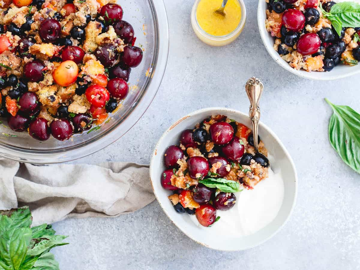 A sweet citrus dressing and fresh basil and mint bring together the sweet vibrant flavors in this summer fruit panzanella.