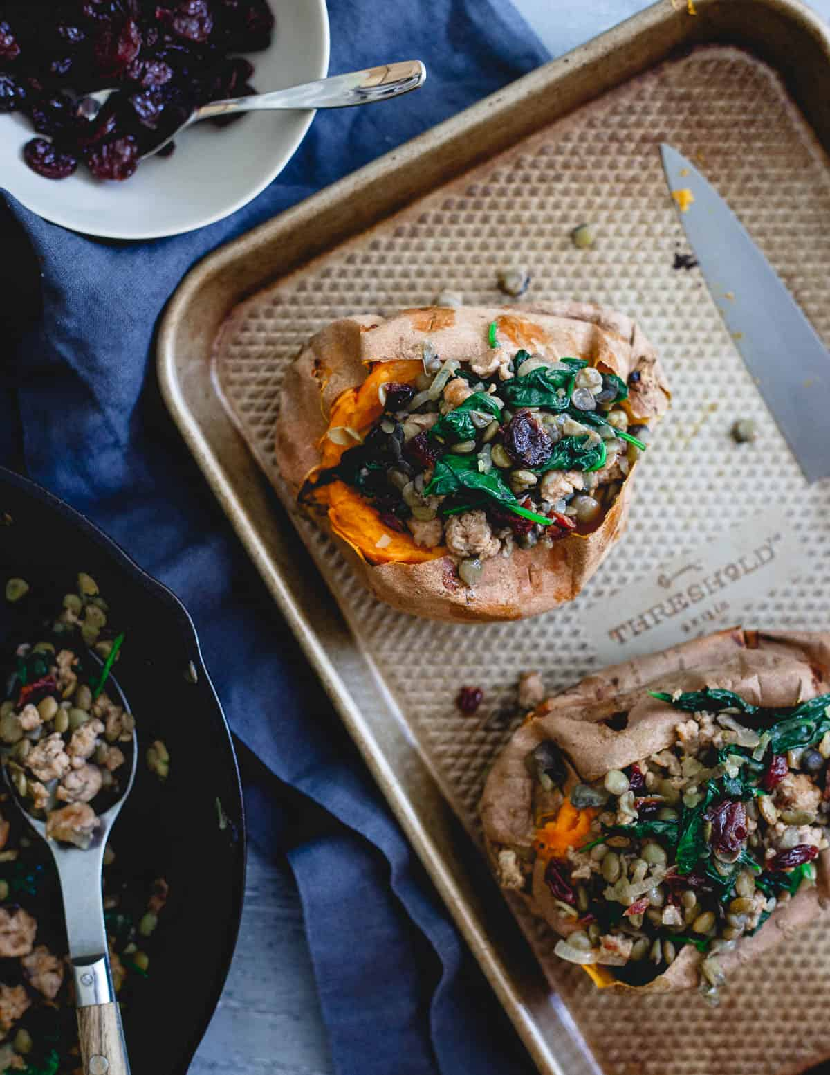 These stuffed sweet potatoes are filled with hot Italian turkey sausage, lentils, tart cherries and spinach. A wholesome way to welcome in the fall season.