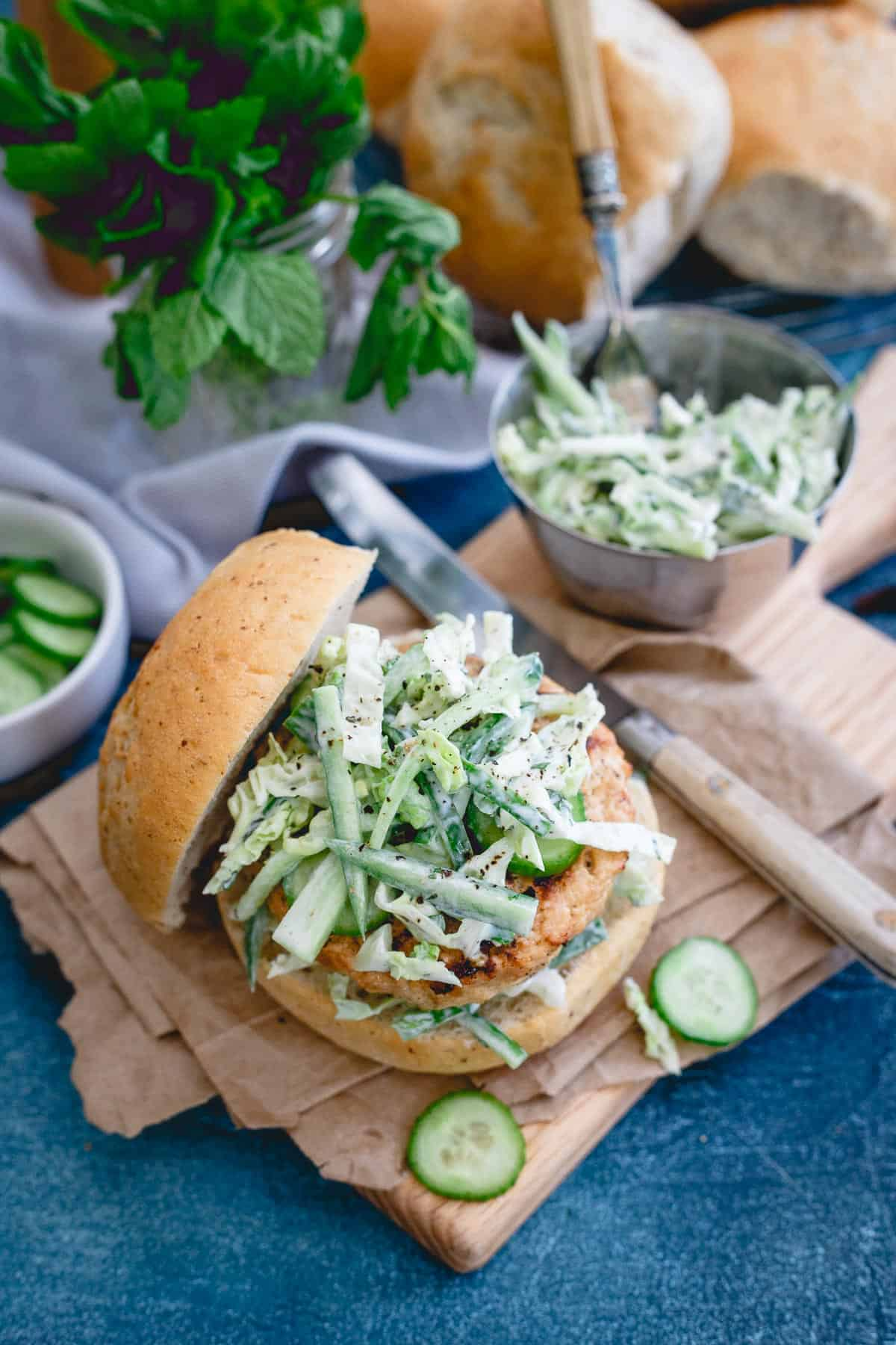 These Indian chicken burgers are topped with a refreshing yogurt cucumber slaw. Perfect beef alternative to throw on the grill.