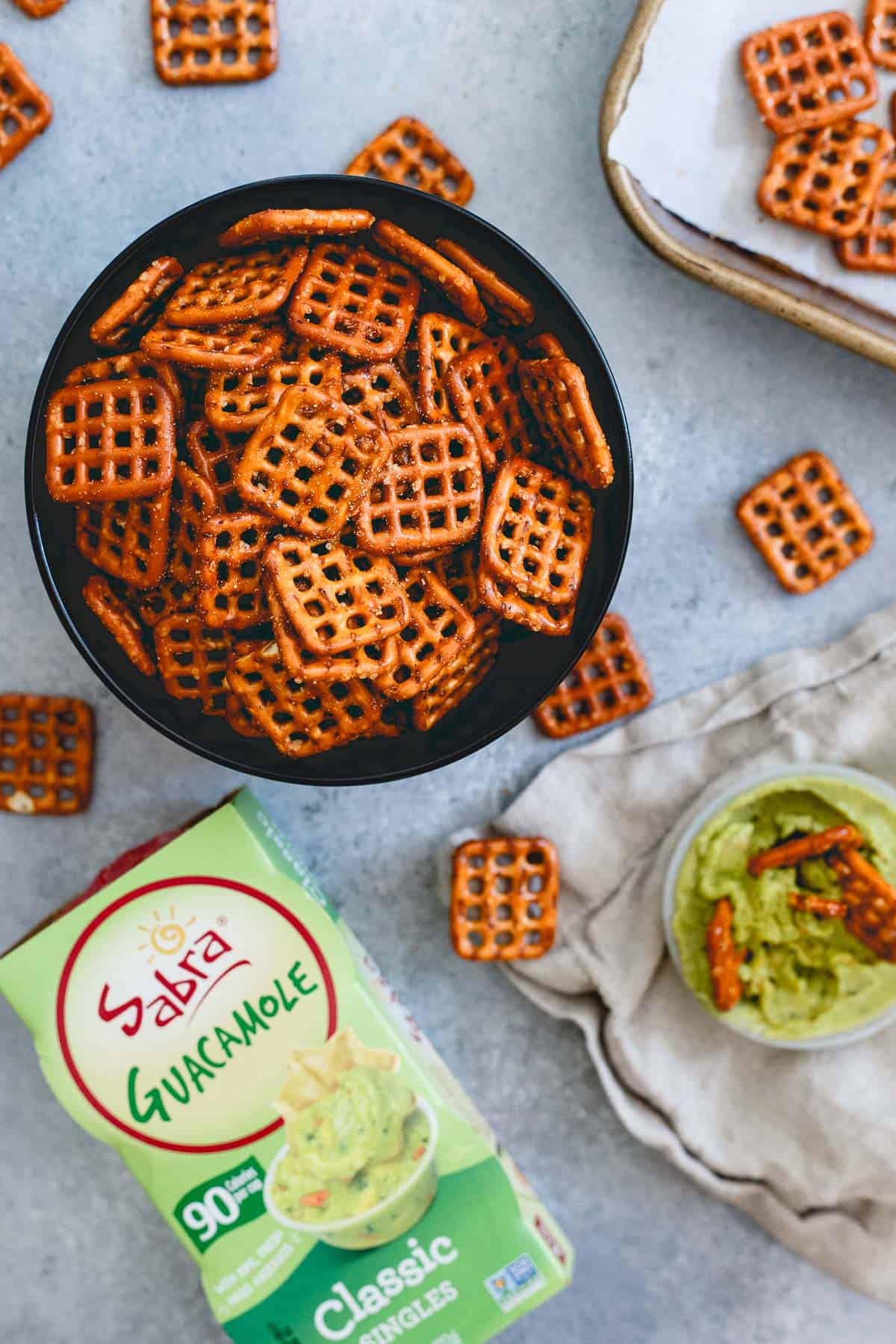 Spicy seasoned pretzels are like the best part of Chex mix in a bowl. Adjust to your taste and dip in some guacamole for an easy homemade snack!