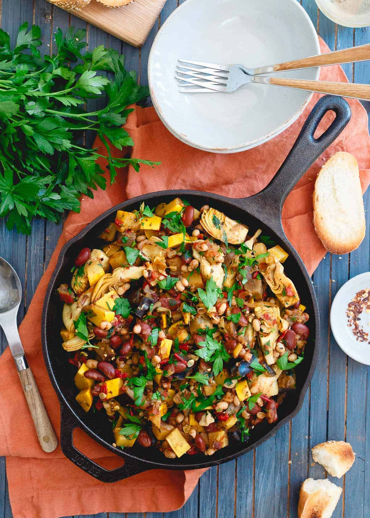 This vegetable bean skillet is packed with all the delicious end of summer garden vegetables and given a hearty, protein boost from two kinds of beans for an easy meatless meal.