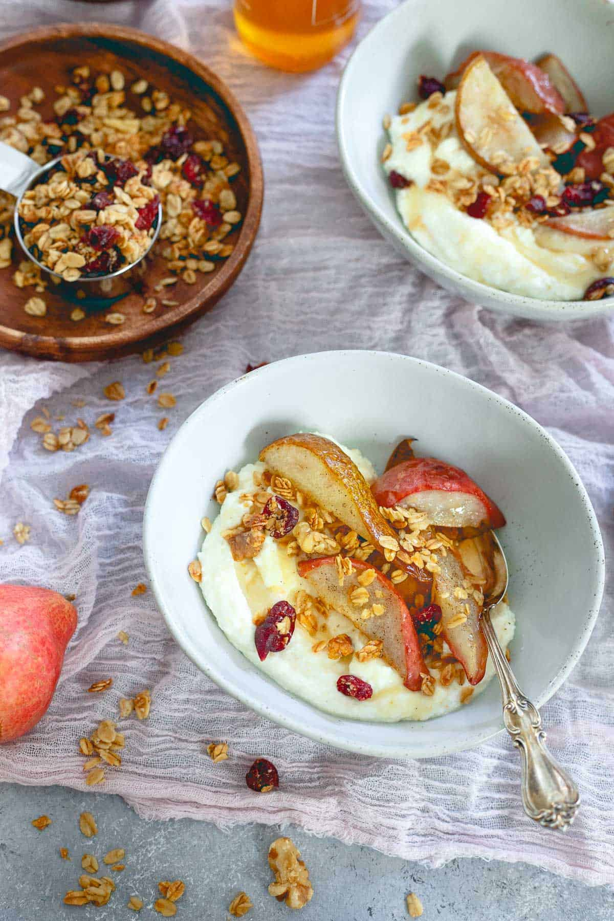 A seasonally delicious snack or breakfast, these whipped ricotta bowls are filled with cranberry granola and roasted pears.