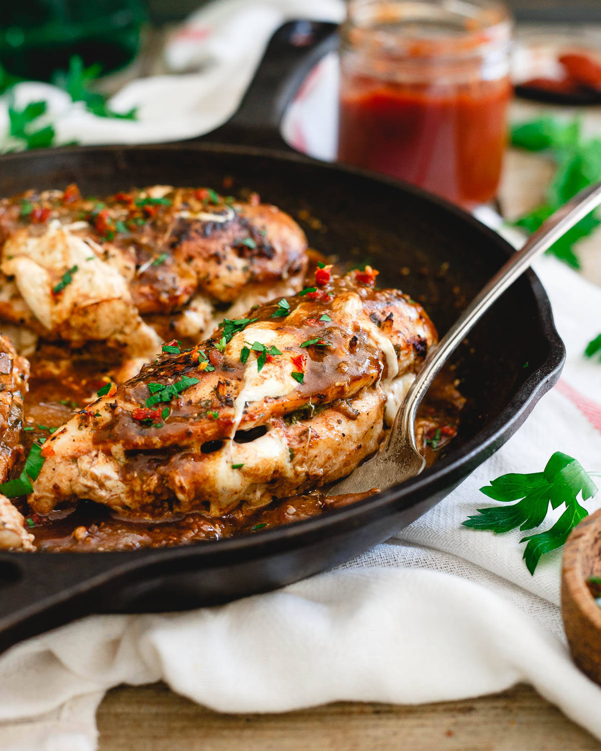 This stuffed chicken marsala is an even more delicious twist on the classic Italian dish with melted mozzarella, sweet and savory tomato butter and fresh basil cooked inside the chicken.